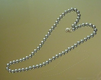 Necklace: pale silver glass pearls on pure silk thread, hand knotted between each bead- perfect for bridal or prom wear or birthday gift