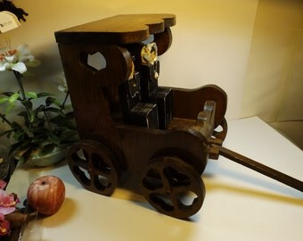 Sale Amish family in wooden wagon.Toy. Project