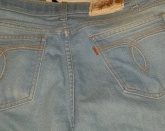 34 x 29 Mens vintage LEVIS jeans. 1970s looped pocket. Orange tag. swooshed loop design pockets. Leather Levis patch