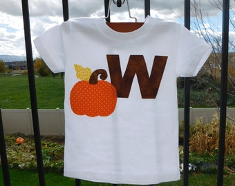 New harvest boy or girl, toddler, tween and baby shirt with fun pumpkin patch applique and personalized brown initial in sizes NB - 16