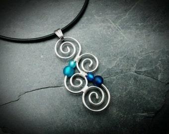 Meaningful Necklace - LUMINATE - with Polarisbeads BLUE  New Zealand Koru wire wrapped, wirework, silver, pendant, handmade, spiral, swirl