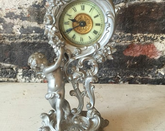 Antique Victorian cast iron small table clock