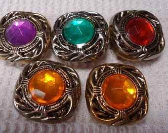 Jewel toned button covers, sold in ones different faux 'jewels' set in metal. Some matched and different designs. Sparkle. KK12.2-B.C. 1.
