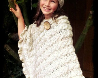 asymmetric knitted poncho ,cable knitted poncho