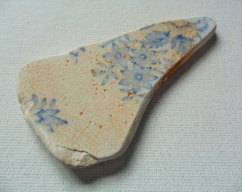 Lovely blue & cream floral pattern sea pottery pendant shaped beach find piece