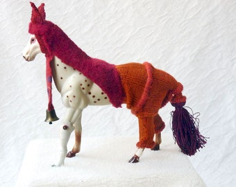 Altered figurine assemblage, Shaman horse with china leg, bell and tassel