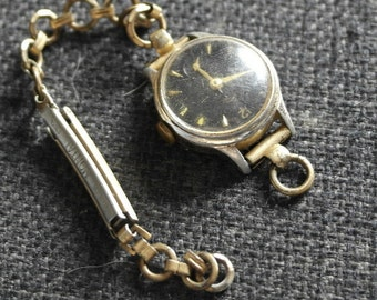 vintage gold tone with black dial and second hand ladies watch by smiths
