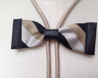 Silk bow tie bolo in striped brown/black with black leather and beige bolo cord (B18)