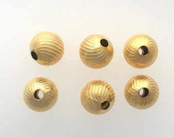 Gold plated corrugated round bead sold in sets of 6 : item # 2510