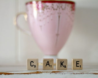 vintage wood block word CAKE