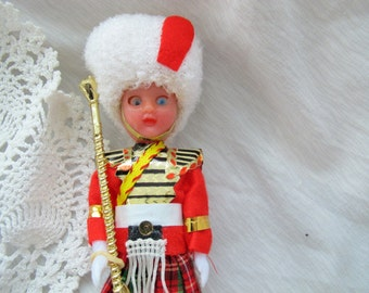 London guard doll / vintage plastic white fur hat miniature British royal guard / Scottish royal guard doll