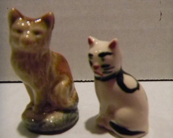 Vintage miniature cat pair of figurines..one Wade Whimsie; one marked USA with an odd painted face!