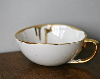 Rustic porcelain teacup with real gold handprinted accent