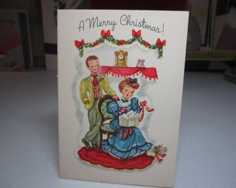 Sweet  1940's-50's christmas card cute victorian couple exchanging gifts A Gibson Card
