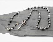 Pagan prayer beads hematite gemstones with a bird skull charm