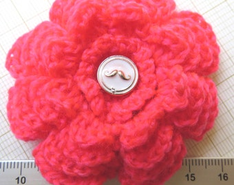 Irish crochet flower brooch in neon pink with moustache glass button centre