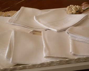 A Set Twelve Vintage White Damask Luncheon or Dinner Napkins in a Elegant Scroll Design Pattern