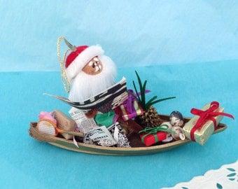 Hawaiian Christmas Ornament - Hawaii St Nick in a Canoe - Mele Kalikimaka - sea glass - cone & Cowry shells - pig - pineapple - collectible
