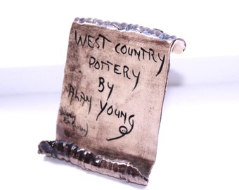 Vintage Alan Young pottery point of sale shop sign