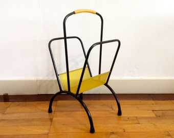 Vintage Tomado Pilastro style two-tone yellow and black metal wire magazine rack or newspaper rack with semi circular legs