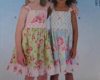 McCalls Girls Dress and Belt Design by Ginger & Louise. Size 2,3,4,5. Pattern is new and uncut. M7076