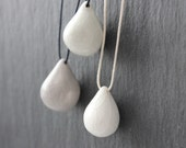 Simple handmade ceramic tear drop necklaces - gray or white, on dark blue or white cotton cord