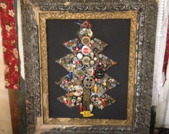 "Christmas tree assembled from found and upcycled materials. 25"" x 30"""
