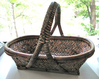 "Woven basket, bamboo basket, elaborate weave, vintage basket, 13 and 3/4"" long, 10"" wide, 8"" high"