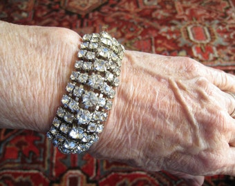 CLEARANCE 5-Row Rhinestone Bracelet is Contoured with 7 mm Stones Along Peak Middle Row and 4 mm Stones in other Rows.