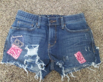 LEVIS denim cut off shorts Hipster Grunge Shredded  cut off shorts size 29 waist Daisy Mae patches