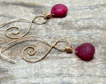 Bohemian ruby earrings Delicate double spiral hoop earrings Wire wrapped red gemstone dangle Genuine ruby teardrop Gold hoop July birthstone