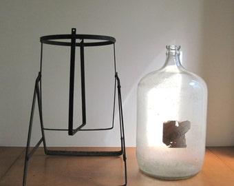 Wheeler Water Tipping Jug, Water Tipper, Glass Terrarium, Industrial Water Jug, Iron Metal Stand, Large Water Bottle, Primitive Bottle