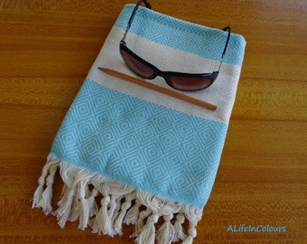 Turkish turquoise colour soft cotton diamond patterned face and hand towel.