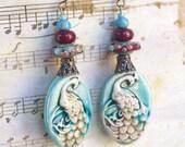 Burgundy Blue Peacock Earrings, Handmade Bird jewelry Gift, Oval Porcelain Drop earring, Rustic Lampwork bead, Ceramic animal earrings