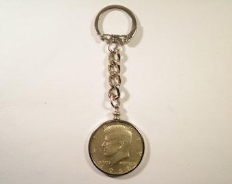 1 Silverplated Key Chain with a 40% Silver Kennedy Half Dollar
