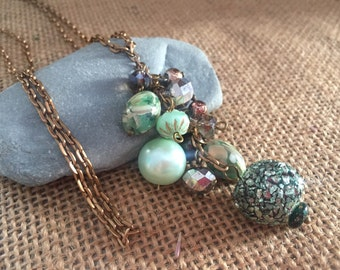 Antique bronze dangle bead cluster necklace