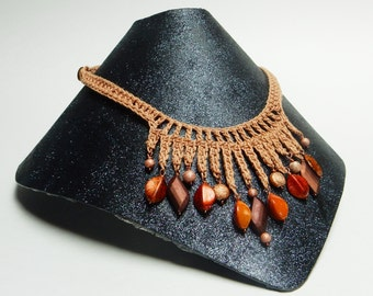 Crocheted statement necklace in copper with funky beads in shades of copper and brown
