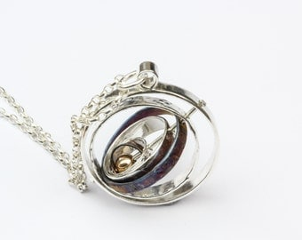 Kinetic Spinning Orbit Necklace - Silver and Gold