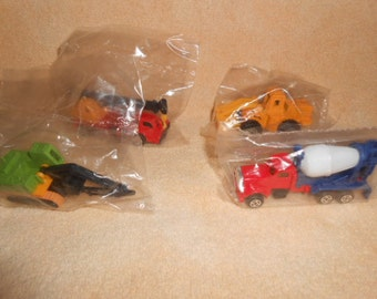 Four Mini Truck Cake ToppersIn Original Bags