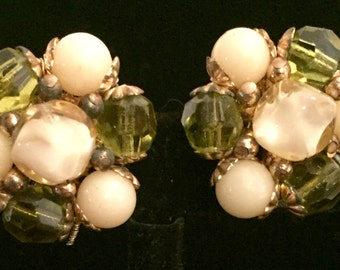 Vintage green and Ivory lucite beaded clip on earrings. High end. Unsigned. Mint condition. Old Hollywood glamour. Classic pin up style.