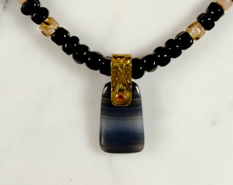 The Pacifik Image's Goodwin and Maxwell handcut and riveted black agate pendant and necklace. Ships free in the USA. Made in the USA
