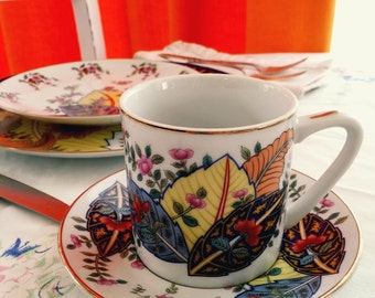 Tobacco leaf China Flat cup and saucer by Mann