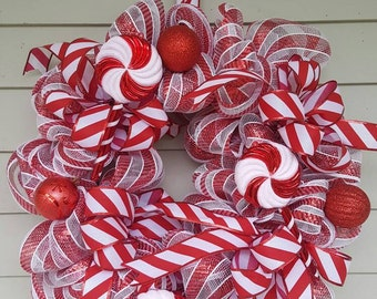 Mesh candy cane wreath, lollipops. Made by a stay at home veteran