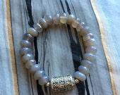 Grey Agate Stretch Bracelet with Silver Tibetan Prayer Wheel