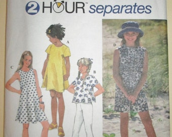 1995 Simplicity 9556 Girl's pullover top, pull on shorts, leggings and flared dress pattern sizes 7 - 10 included UNCUT