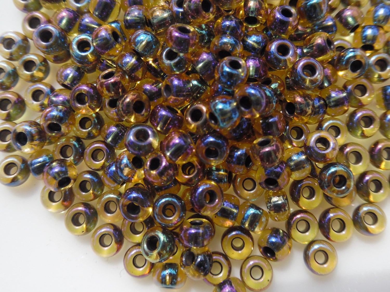 size 6 0 pony bead transparent blacklined topaz ab iris