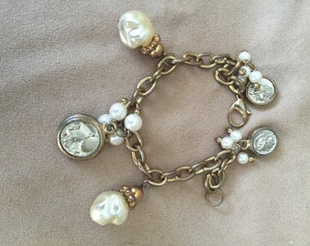 Vintage charm bracelet in gold tone metal