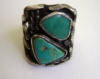 large and chunky, a sterling/turquoise ring, size 8.75