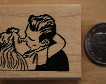 Kissing couple rubber stamp