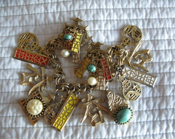 Asian Charm Bracelet 7 1/4 Inches Gold Tone with matching Earrings